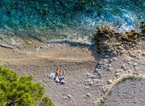 Fotografija Lifestyle hotela, par leži na plaži